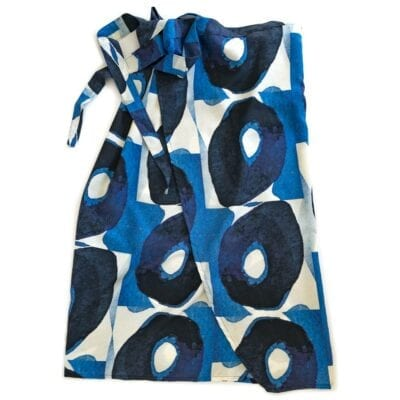 blue and white olive patterned wrap tied at the waist