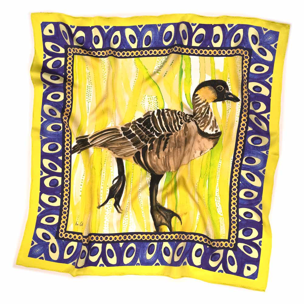 square silk scarf with brown goose, and a bright green and yellow background with a blue border