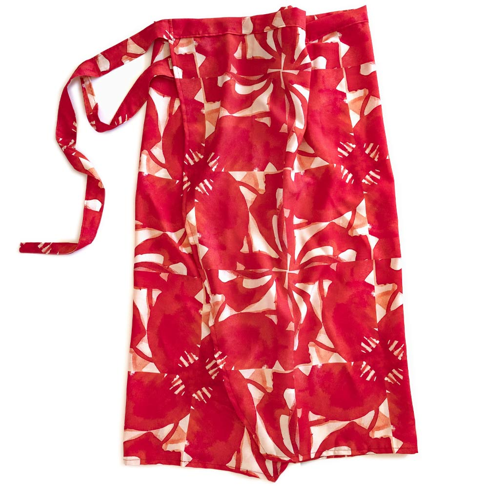 red floral pinwheel patterned wrap tied at the waist