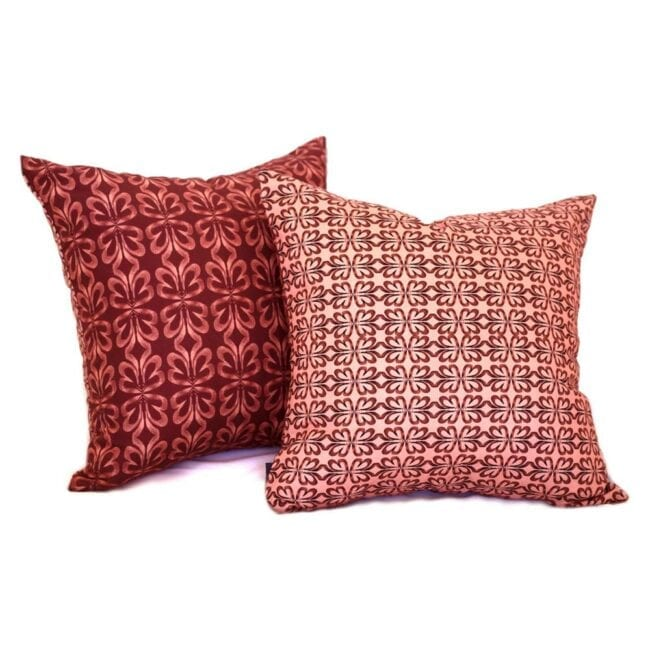 red clay and pink botanical throw pillow