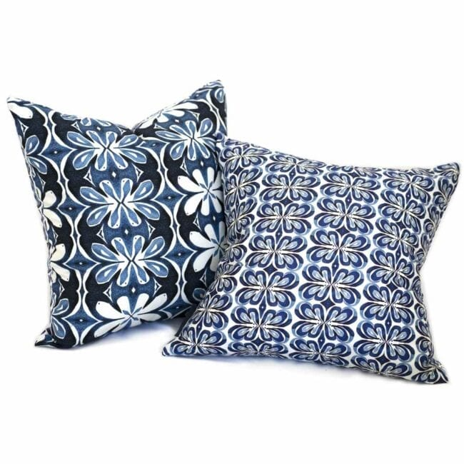 two different blue and white botanical throw pillow