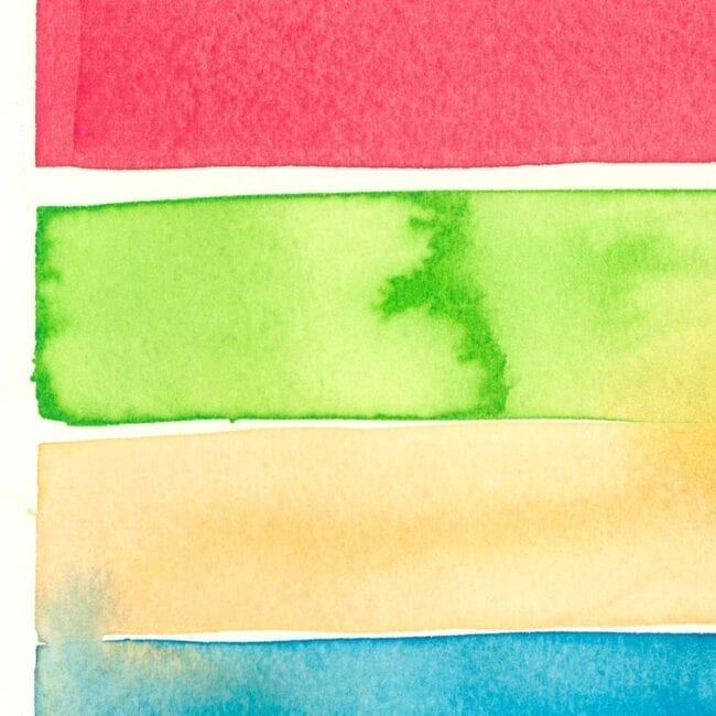 light red, green, tan and cyan watercolor stripes with watercolor seepage