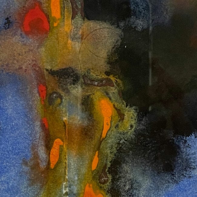 Up-close of an abstract painting with blue, red, orange, green, and black, representing Cancer
