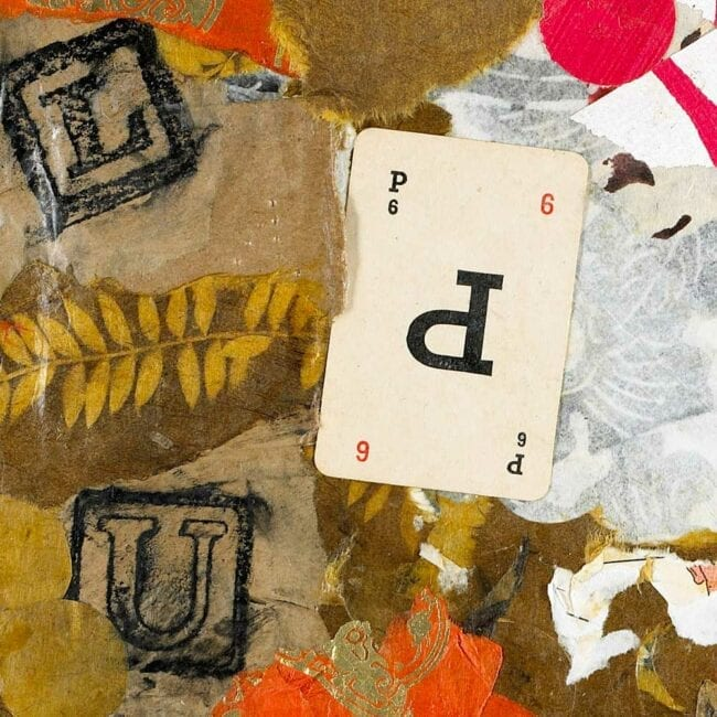 mixed media collage with brown paper and a number six playing card