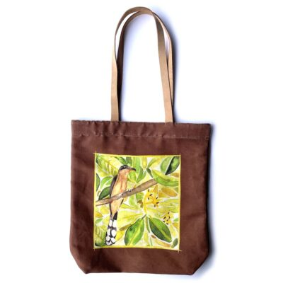 a brown tote bag with light leather straps featuring a mangrove cuckoo in a mangrove forest in the center