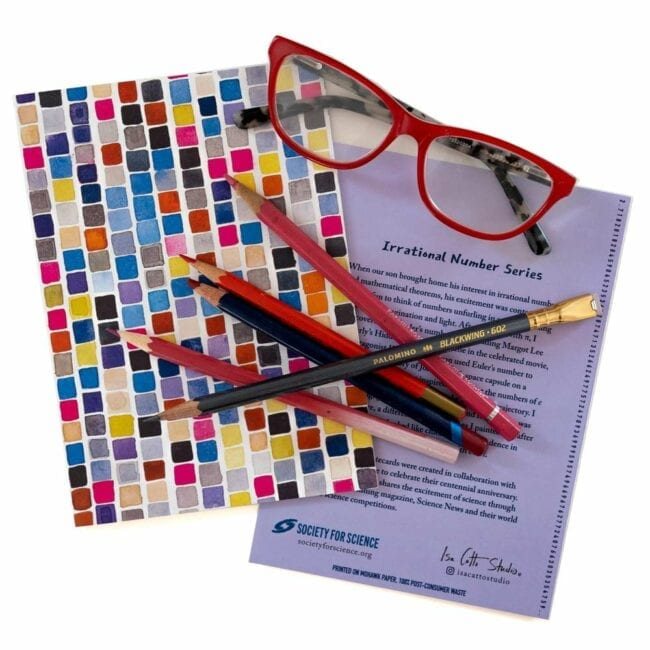colorful squares notecard staged with red pencils and glasses
