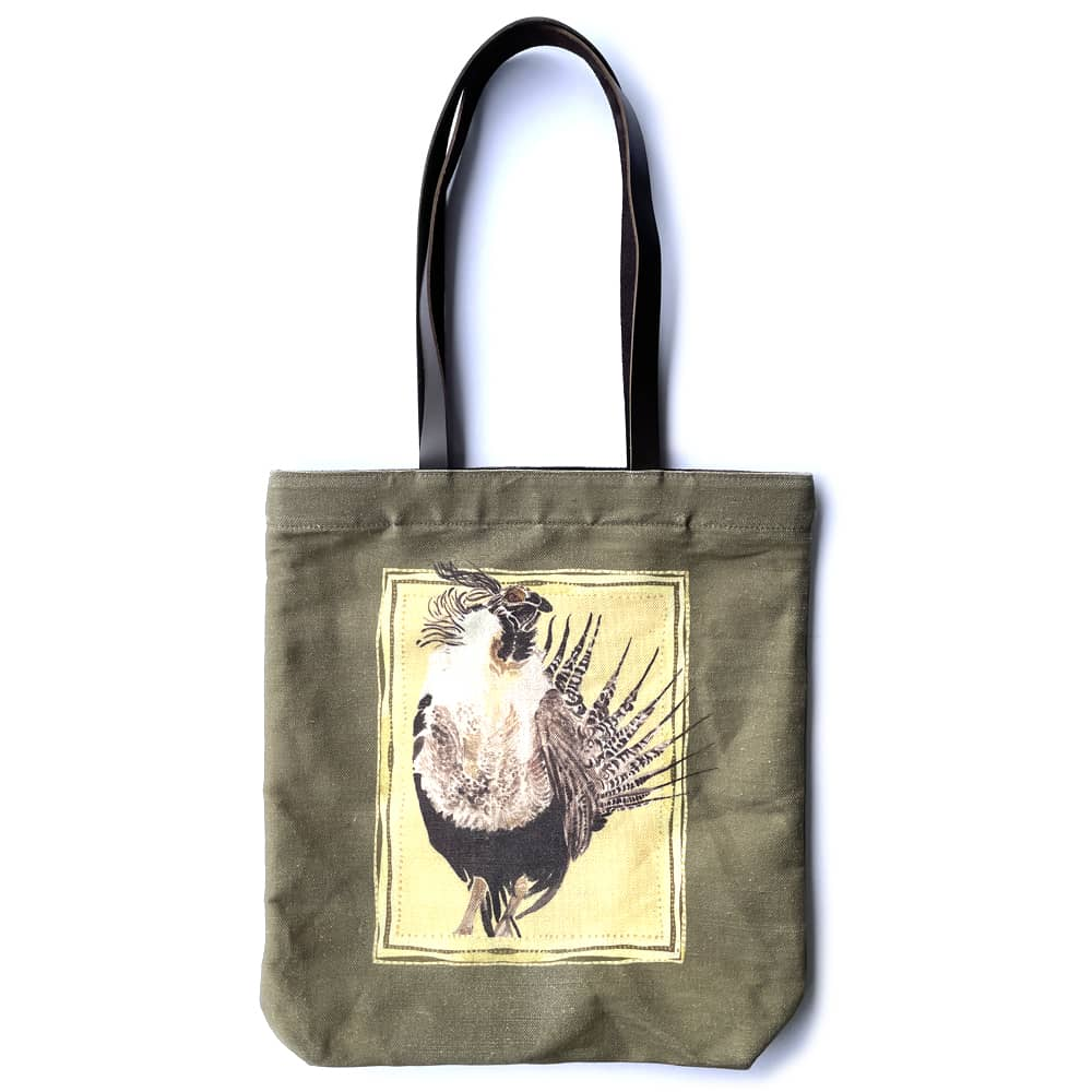 an olive green tote bag featuring a brown gunnison sage grouse in the center, with a yellow background