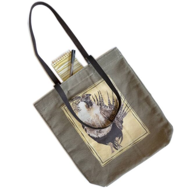 tote bag with a gunnison sage grouse on an olive bag with a sage brush themed notebook and a brown marker