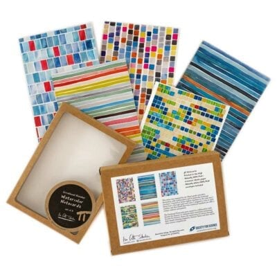 a group of colorful geometric notecards with their packaging