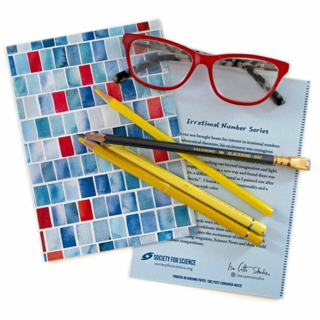 blue and red squares notecard with yellow pencils and red glasses