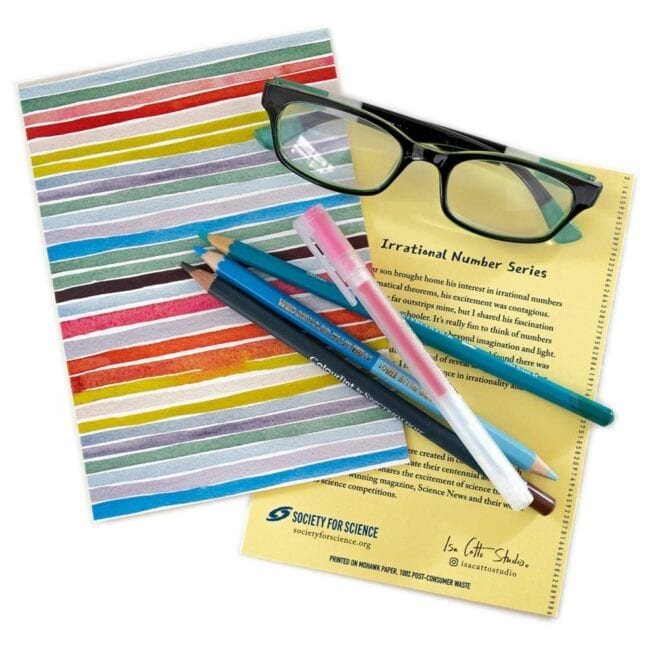 colorful stripes of red, yellow, blue, and green notecards with green glasses and matching pencils