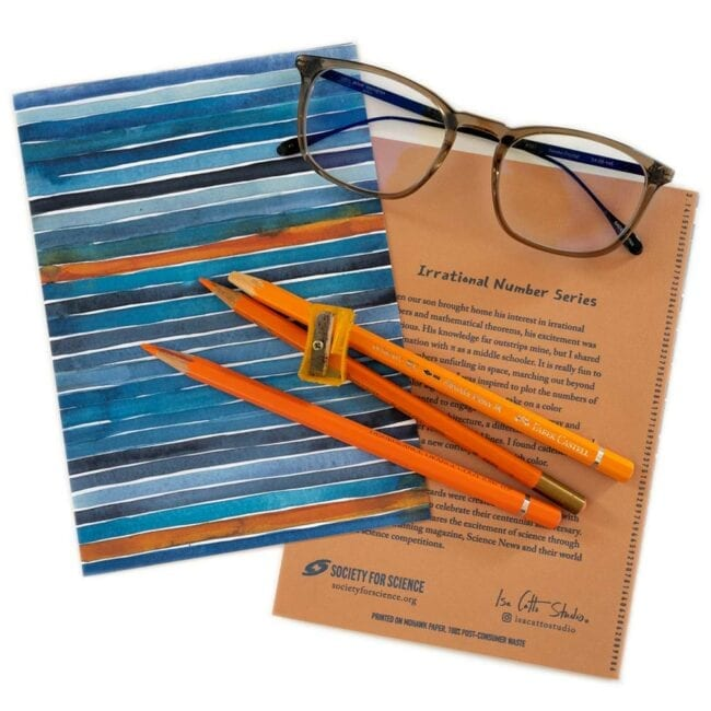 blue and orange striped notecards with orange pencils and glasses