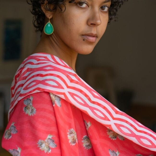 Detail shot of model with pink double-sided pink hummingbird and striped scarf