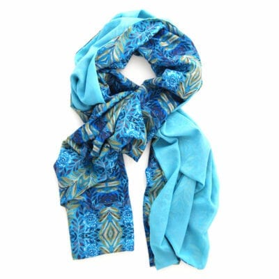 double sided chiffon scarf with peacock blue on one side and a lush geometric blue and yellow garden pattern on the reverse