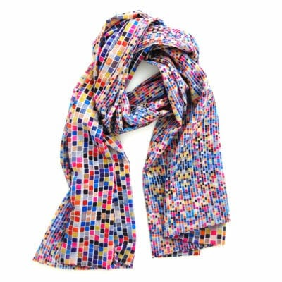 colorful geometric squares cover this long chiffon scarf, on one side the squares are larger than the reverse side creating dynamic movement