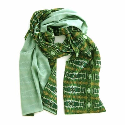 double sided chiffon scarf with light green back and geometric green and umber garden inspired pattern on the front