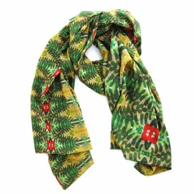 double sided chiffon scarf with a green, yellow and red bohemian garden inspired pattern, one side has the pattern in a large scale and the other smaller