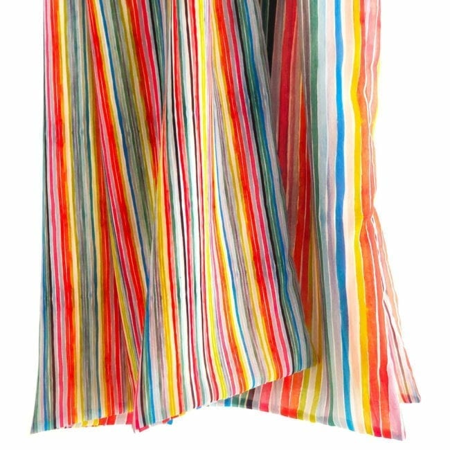 detail of colorful striped chiffon scarf; vibrant stripes are hand painted one side of scarf has thinner stripes than the reverse