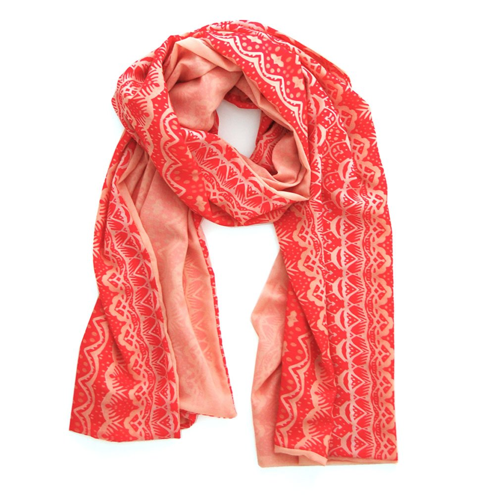 double layered chiffon scarf with a geometric watermelon pattern on one side and a light peach on the other