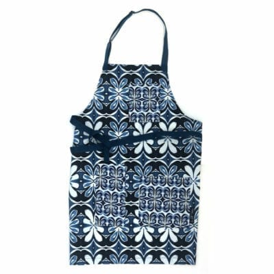 indigo lotus pattern on a full sized apron with three pockets that have similar style pattern in smaller scale with blue webbing for neck and waist strap