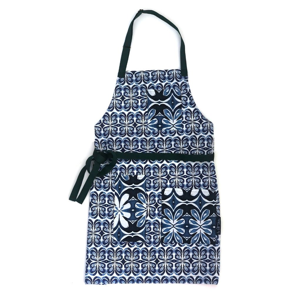 indigo lotus patterned apron with three pockets that have a similar pattern in a larger scale with blue waist and neck webbing