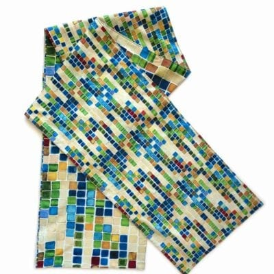 colorful geometric squares of different scales on a long table runner