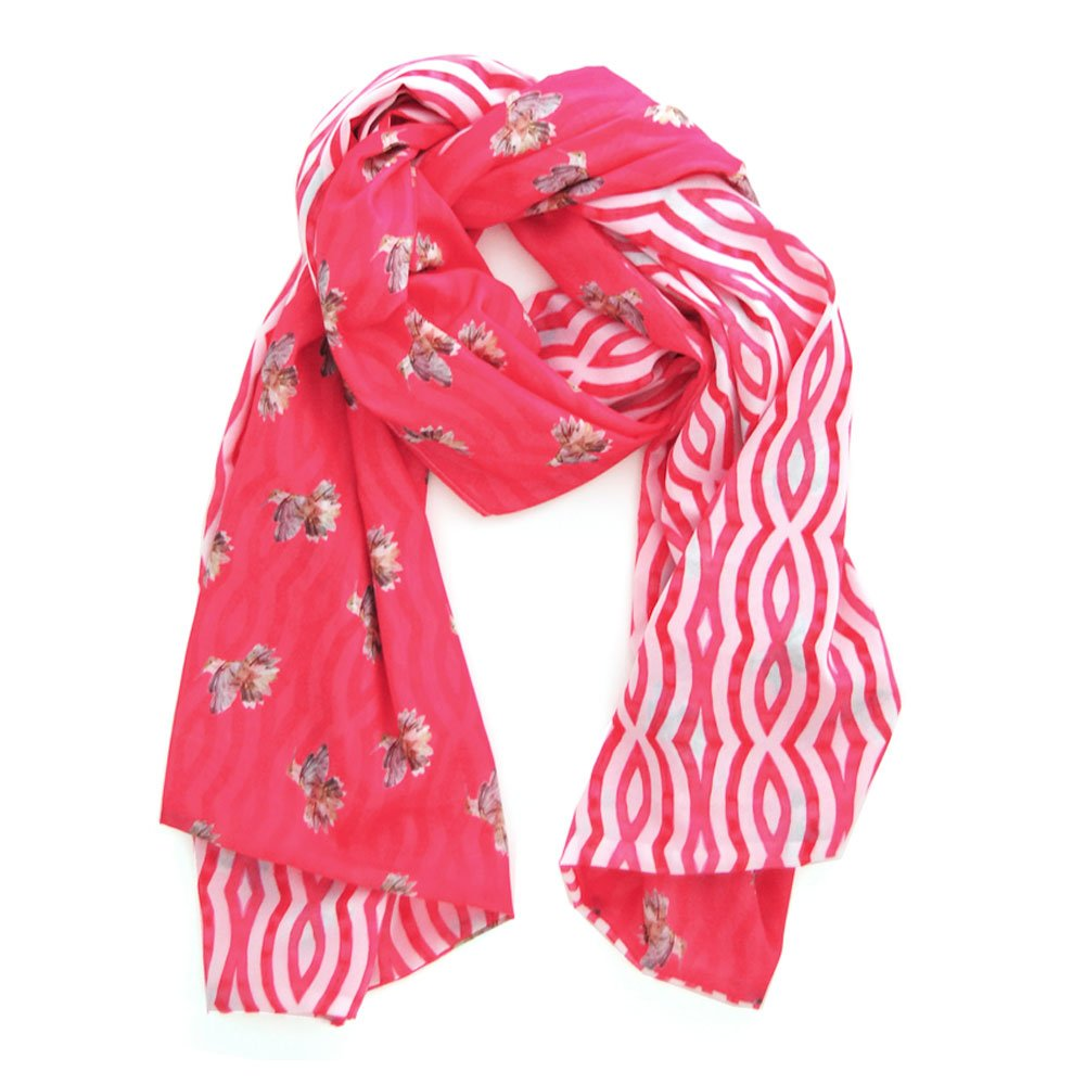 a vibrant scarf with a vivid pink background and illustrated hummingbirds on one side with hand painted wavy vivid pink lines on the back