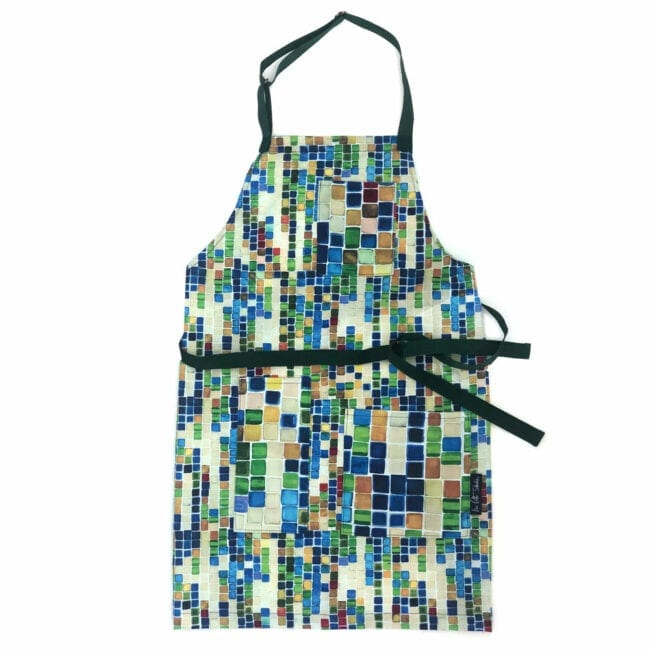 colorful geometric squares in a full size apron with smaller pattern on the three pockets with a blue waist and neck straps
