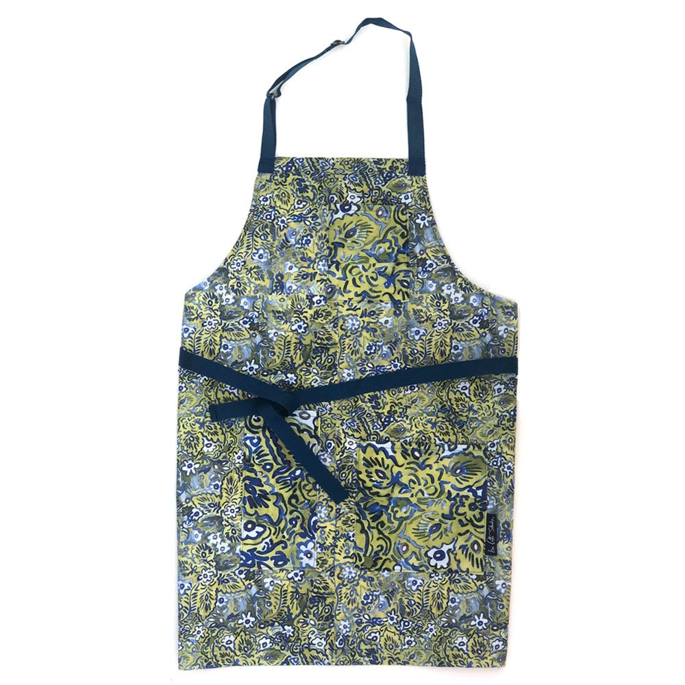 Full size apron with a green blue and white floral pattern; pockets have same pattern in a contrasting scale; waist and neck ties in a blue webbing