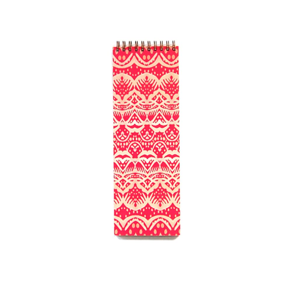 long skinny notebook, great for to-do lists, pattern is a geometric pink cloverleaf on top of a red clay background