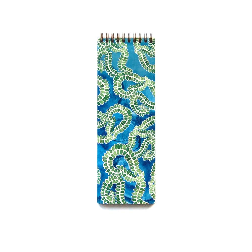 skinny notebook, great for list making, watercolor holly leaves in a curvy design set against a watercolor indigo background
