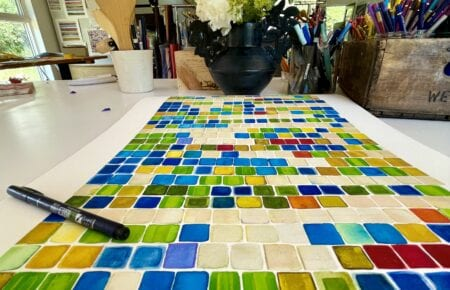 watercolor painting of colorful geometric blue, green and yellow squares based on an irrational number algorithm
