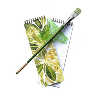 green and gold foliage organizational notebook cover with a triangle and green paintbrush showing the inside sheets of the notebook