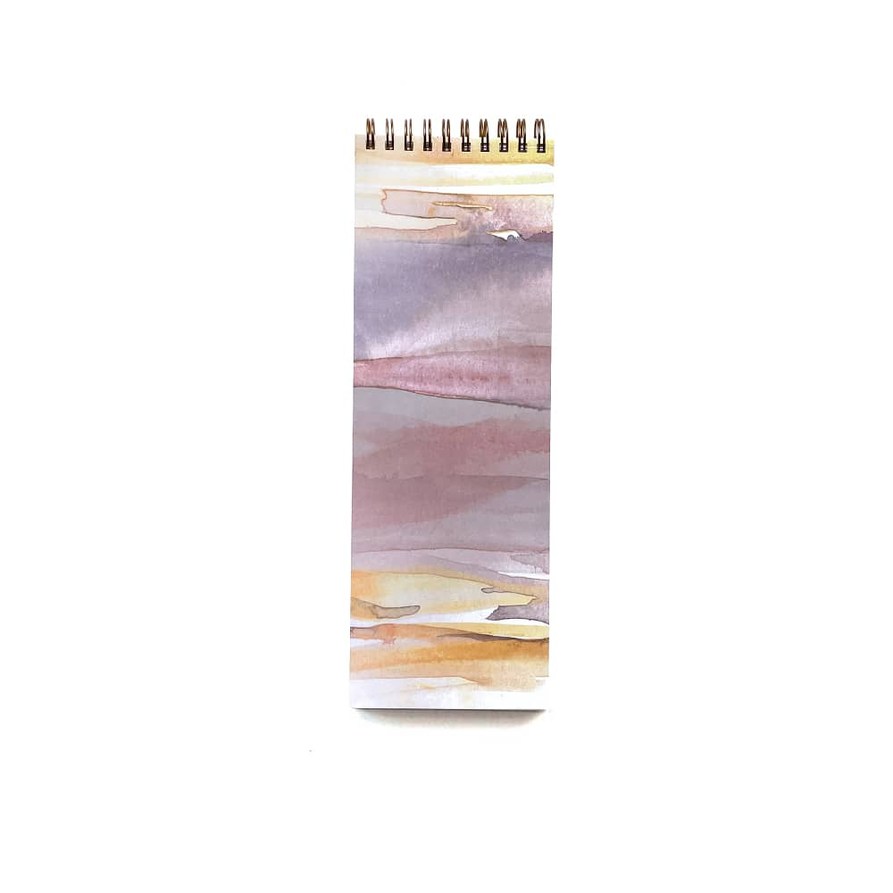 sunset on an organizational notebook featuring a pink and yellow sunset