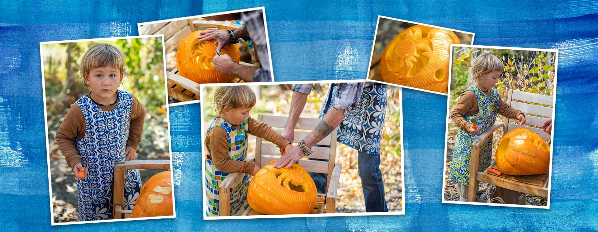 man and a young boy carving a pumpkin together wearing colorful aprons